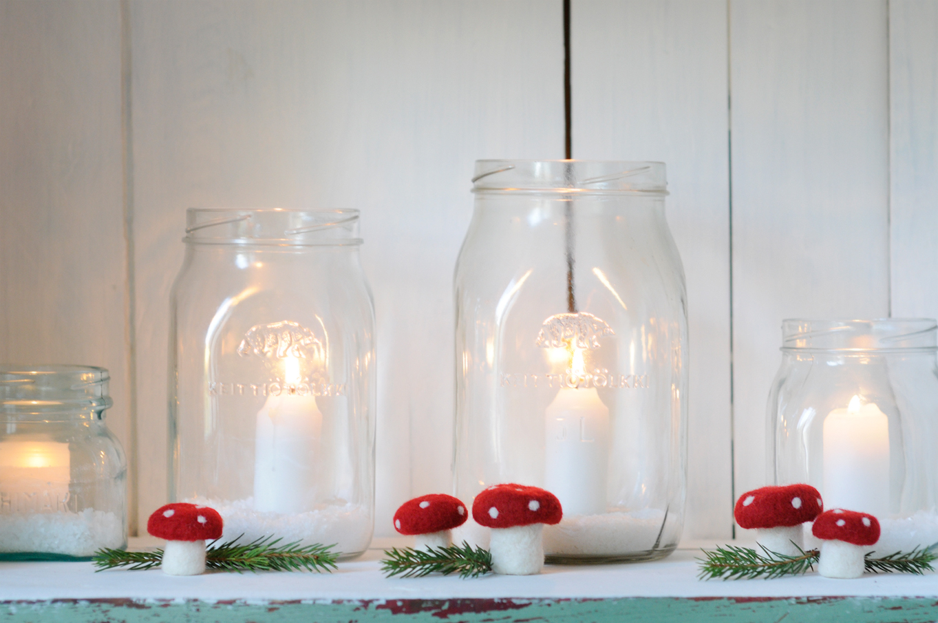 Vintage glass jars as candle holders